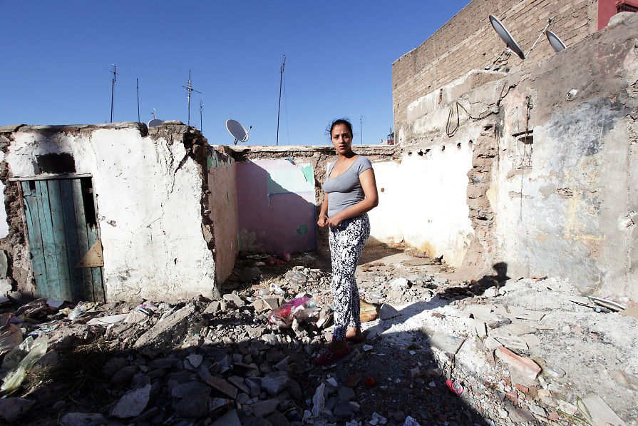 Rachida single mother of 31 years old stands on one destroyed part of the slum located just behind her mother's house - Bab Doukala District - Marrakech May 2013