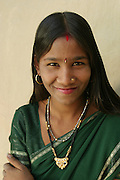 IND.MWdrv04.373.x..Bachau and Mishri Yadav's oldest child, daughter Nishadevi, 19, called Guddi, is betrothed by family arrangement to a boy living in a village 30 km from her home village of Ahraura Village, Uttar Pradesh, India. Revisit with the family, 2004. The Yadavs were India's participants in Material World: A Global Family Portrait, 1994 (pages: 64-65), for which they took all of their possessions out of their house for a family-and-possessions-portrait. Child, Children, Marriage..
