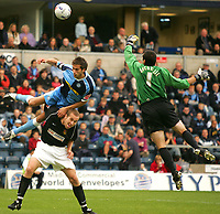 Photo: Frances Leader.<br />Wycombe Wanderers v Chester City. Coca Cola League 2.<br />01/10/2005.<br /><br />Chester's goalie Chris Mackenzie punces the ball away from goal as Wycombe's captain Roger Johnson head the ball over chester's David Artell's head