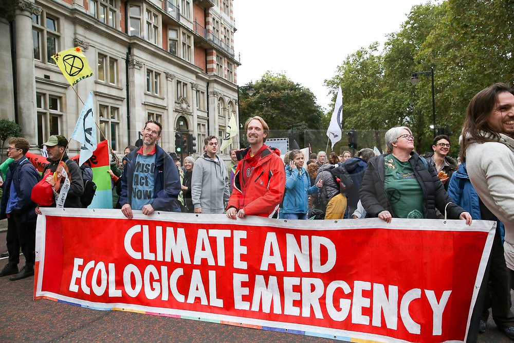 © Licensed to London News Pictures. 07/10/2019. London, UK. Environmental and climate change activists from the Extinction Rebellion group block Birdcage Walk in Westminster as the group protest calling for the UK Government to take responsibility and enact immediate, profound and sweeping changes to address the crisis on climate and ecological changes. Photo credit: Dinendra Haria/LNP