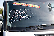 Reduced van purchase price advertised on windscreen, vehicle sales dealership, Ransomes Europark, Ipswich, Suffolk, England