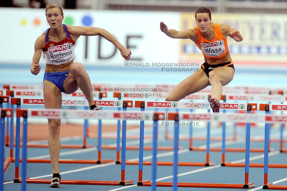 06-03-2009 ATLETIEK: EK INDOOR: TURIJN <br /> Yvonne Wisse wordt derde op de 60 meter horde , anna bogdanova wint de heat<br /> &copy;2009-WWW.FOTOHOOGENDOORN.NL