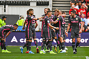 Patrick Bamford of Leeds United (9) scores a goal and celebrates with teammates to make the score 0-2 during the EFL Sky Bet Championship match between Bristol City and Leeds United at Ashton Gate, Bristol, England on 4 August 2019.