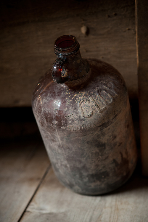 Glass clorox bottle found in a barn.<br /> Country life and Agriculture.<br /> Photographed by editorial lifestyle photographer Nathan Lindstrom