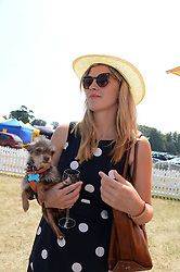 ANNABEL SIMPSON and her dog Coco at the Veuve Clicquot Gold Cup, Cowdray Park, Midhurst, West Sussex on 21st July 2013.