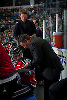 KELOWNA, CANADA - SEPTEMBER 20: Dan Lambert, head coach of the Kelowna Rockets speaks to Cole Linaker #26 on the bench opposite the Kamloops Blazers on September 20, 2014 at Prospera Place in Kelowna, British Columbia, Canada.   (Photo by Marissa Baecker/Shoot the Breeze)  *** Local Caption *** Dan Lambert; Cole Linaker;