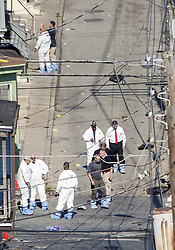 September 30, 2018 - Allentown, Pennsylvania, U.S. - Police join members of the ATF and the FBI as they investigate North Hall Street (between Turner and Linden streets) after a fiery car explosion rocked the neighborhood on Saturday. (Credit Image: © Harry Fisher/Allentown Morning Call/TNS via ZUMA Wire)