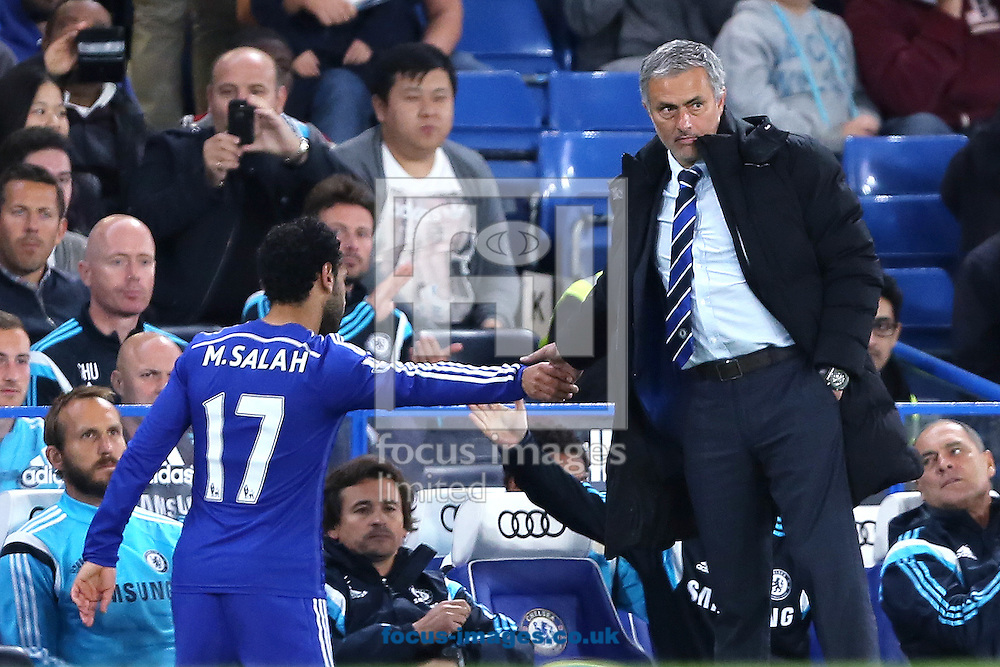 Manager of Chelsea, Jose Mourinho acknowledges Mohamed Salah after being substituted during the Capital One Cup match against Bolton Wanderers  at Stamford Bridge, London<br /> Picture by Richard Calver/Focus Images Ltd +447792 981244<br /> 24/09/2014