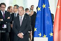 09 JUL 2018, BERLIN/GERMANY:<br /> Olaf Scholz, SPD, Bundesfinanzminister, neben einer Europa-Flagge, waehrend der Unterzeichnung von Regierungs- und Wirtschaftsabkommen im Rahmen der Deutsch-Chinesische Regierungskonsultationen, Bundeskanzleramt<br /> IMAGE: 20180709-02-002<br /> KEYWORDS: EU