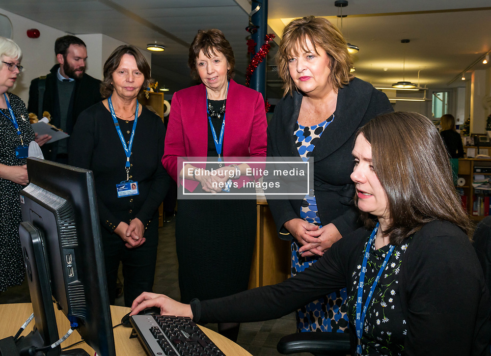 Pictured: Scottish Government Public Libraries Funding Announcement. Culture Minister Fiona Hyslop announces this year's successful bids to the £450,000 Public Library Improvement Fund (PLIF) at the John Grey Centre, Haddington Library, Haddington, East Lothian, Scotland, United Kingdom.  PLIF has been supporting innovative library projects since 2006 which help both individuals and communities. Fiona Hyslop and hte Depute Chief Executive of East Lothian Council,  Monica Patterson. A member of staff demonstrates the use of Boardmaker for children with communication difficulties. Pictured L to R: Trina Gavan, Area Librarian, Depute Chief Executive of East Lothian Council,  Monica Patterson. and Fiona Hyslop. 13 December 2018  <br /> <br /> Sally Anderson | EdinburghElitemedia.co.uk