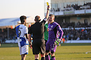 Scunthorpe United  Matt Gilks (1) is given a yellow card by Referee Darren Handley during the EFL Sky Bet League 1 match between Bristol Rovers and Scunthorpe United at the Memorial Stadium, Bristol, England on 24 February 2018. Picture by Gary Learmonth.