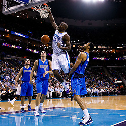 November 17, 2010; New Orleans, LA, USA; New Orleans Hornets center Emeka Okafor (50) dunks over Dallas Mavericks center Tyson Chandler (6) and power forward Dirk Nowitzki (41) of Germany during the second half at the New Orleans Arena. The Hornets defeated the Mavericks 99-97. Mandatory Credit: Derick E. Hingle