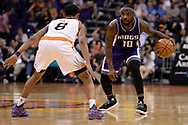 Mar 15, 2017; Phoenix, AZ, USA; Sacramento Kings guard Ty Lawson (10) handles the ball in front of Phoenix Suns forward Derrick Jones Jr. (10) in the second half at Talking Stick Resort Arena. The Sacramento Kings won 107 - 101. Mandatory Credit: Jennifer Stewart-USA TODAY Sports