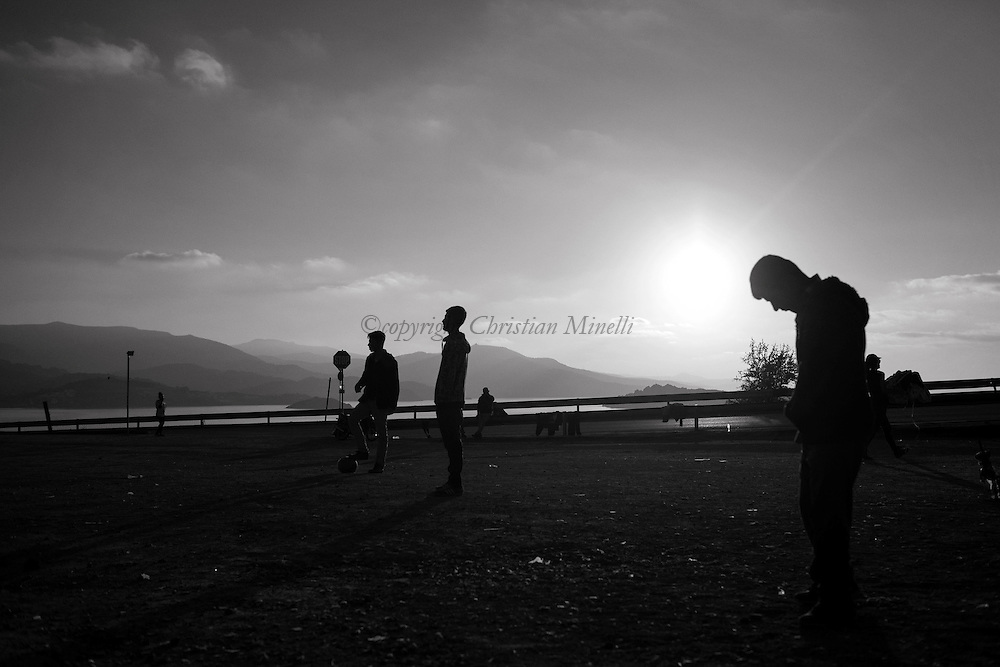 Migrants play football in OXY transit camp in Lesbos on November 16, 2015. Since the start of the summer, the Greek island of Lesbos has assumed notoriety as the main gateway into Europe for thousands of desperate refugees that continue to cross the Aegean sea from Turkey every day.