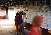 Primary school girls leave their burnt and demolished school in Nazarabad in SWAT. ..Most children are looking forward to returning to school but as yet funding for new premises and books, resources etc has not materialised from central government..