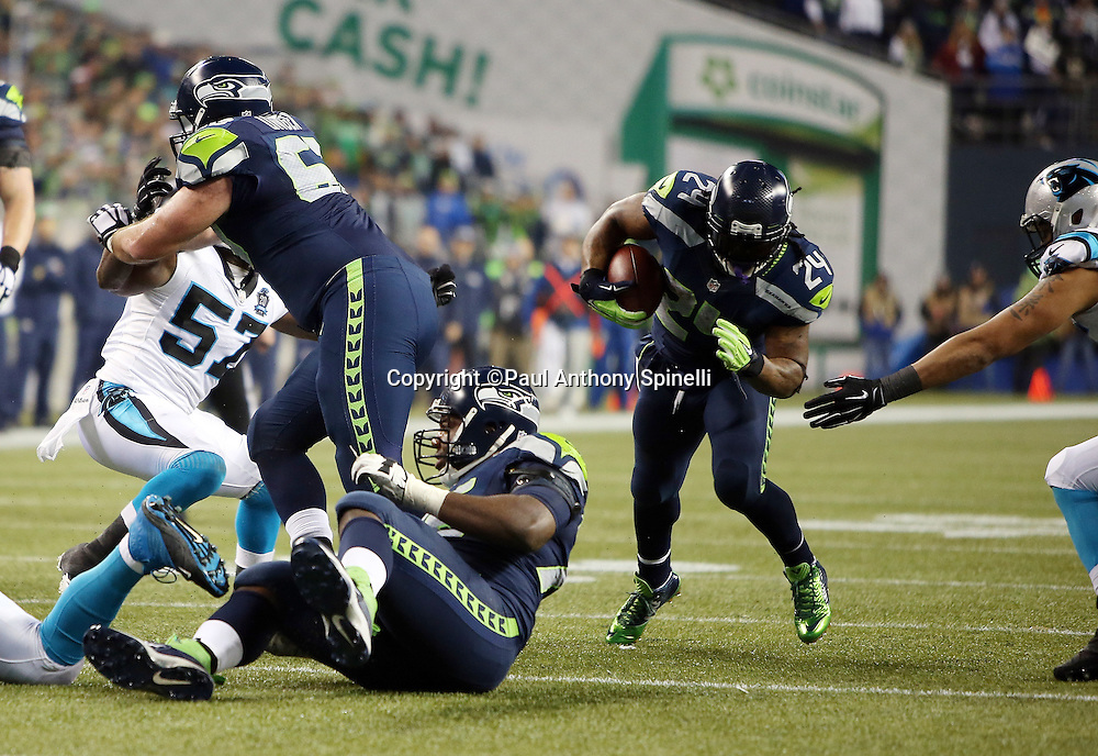 Seattle Seahawks running back Marshawn Lynch (24) runs the ball in the third quarter during the NFL week 19 NFC Divisional Playoff football game against the Carolina Panthers on Saturday, Jan. 10, 2015 in Seattle. The Seahawks won the game 31-17. ©Paul Anthony Spinelli