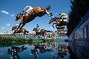 April 28, 2018: Queen's Cup Steeplechase. CODRINGTON COLLEGE (red cap closest) ridden by Darren Nagle, trained by Jonathan Sheppard and owned by Hudson River Farms wins the Maiden Timber race on the George A. Strawbridge, Sr. Memorial Timber Course at Queen's Cup Steeplechase.