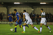 AFC Wimbledon striker Lyle Taylor (33) and Plymouth Argyle defender & captain Gary Miller (2) during the EFL Trophy match between AFC Wimbledon and Plymouth Argyle at the Cherry Red Records Stadium, Kingston, England on 4 October 2016. Photo by Stuart Butcher.