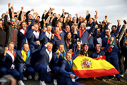 Team Europe captain Thomas Bjorn celebrates with the Ryder Cup trophy alongside players on day three of the Ryder Cup at Le Golf National, Saint-Quentin-en-Yvelines, Paris.