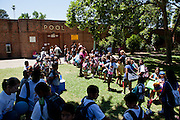 Over a hundred children wait for Clunie Pool to open for just four hours in Sacramento, Calif. on July 1, 2011. Budget cuts have closed many of Sacramento's public pools.