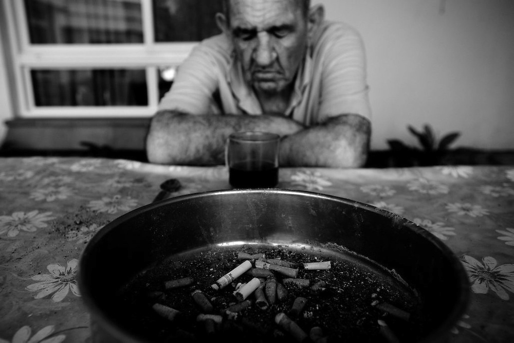 Bulgarian born holocaust survivor Yakov Assa sits in the yard of the Shaar Menashe Mental Health Center for Holocaust survivors in Pardes Hanna, Israel on Oct 20, 2010. .