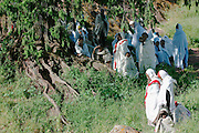 LALIBELA, WELO/ETHIOPIA..Sunday churchgoers visiting the famous rock-hewn churches, result of a delirious phantasy of King Lalibela, who had fallen into a coma due to a failed poisoning attack..(Photo by Heimo Aga)