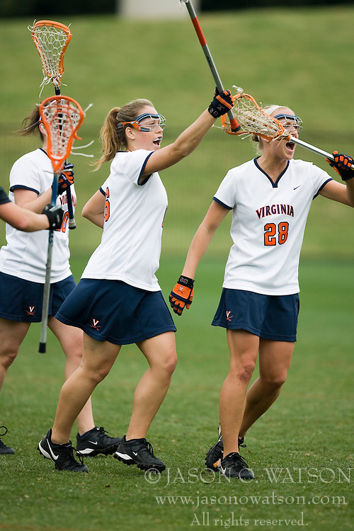 Virginia Cavaliers A Ashley McCulloch (16) celebrates scoring a goal with Virginia Cavaliers A Megan O'Malley (28) and other teammates.  The Virginia Cavaliers women's lacrosse team defeated the Princeton Tigers 9-7 at Klockner Stadium in Charlottesville, VA on March 24, 2007.