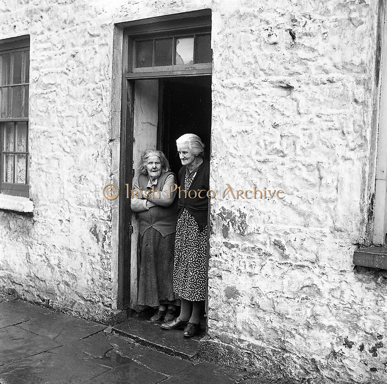 Mrs. Bridget O'Riordan and Mrs. Mary Kelly standing at the door of their rooms at the Corporation Widows Alms House, Limerick..28.03.1962.<br /> <br /> <br /> Icon images, photo of IrelandCarrigtwohil,lCounty Cork,<br /> Icon images, photo of IrelandCashel,County Tipperary,<br /> Icon images, photo of IrelandKilcoole,County Wicklow,<br /> Icon images, photo of IrelandDuleek,County Meath,<br /> Icon images, photo of IrelandCarrick-on-Shannon,County Leitrim,<br /> Icon images, photo of IrelandTullow,County Carlow,<br /> Icon images, photo of Ireland