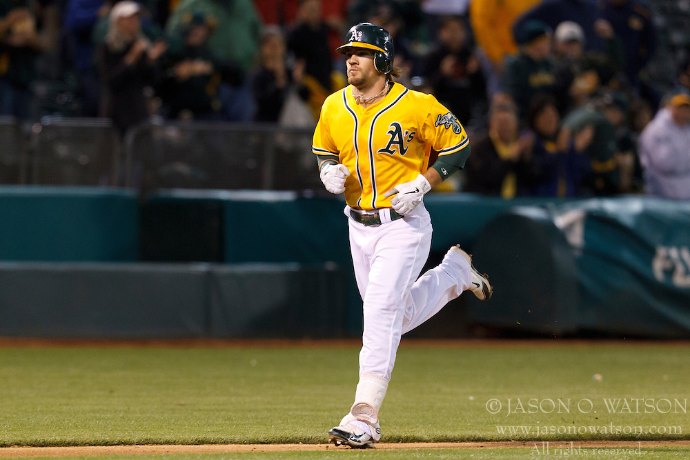 OAKLAND, CA - JUNE 05: Collin Cowgill #12 of the Oakland Athletics rounds the bases after hitting a home run against the Texas Rangers during the fifth inning at O.co Coliseum on June 5, 2012 in Oakland, California. The Texas Rangers defeated the Oakland Athletics 6-3. (Photo by Jason O. Watson/Getty Images) *** Local Caption *** Collin Cowgill