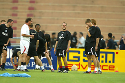 BANGKOK, THAILAND - Wednesday, July 23, 2003: Liverpool Michael Owen shares a joke with Phil Thompson (l) during training session in Bangkok. (Pic by David Rawcliffe/Propaganda)