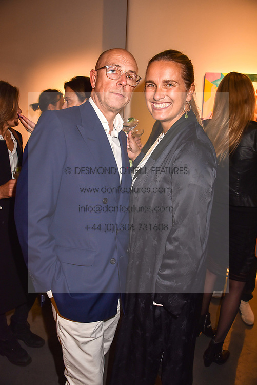 Dylan Jones and Sarah Walter at a VIP private view of 21st Century Women held at Unit London, Hanover Square, London England. 03 October 2018.