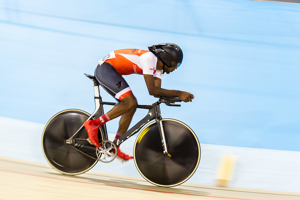 Varuna Maharajh of Trinidad and Tobago competes in the men's omnium individual pursuit on the fist day of track cycling at the 2015 Pan American Games in Toronto, Canada, July 16,  2015.  AFP PHOTO/GEOFF ROBINS