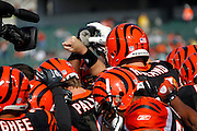 Cincinnati Bengals players join hands prior to the NFL week 8 football game against the Miami Dolphins on Sunday, October 31, 2010 in Cincinnati, Ohio. The Dolphins won the game 22-14. (©Paul Anthony Spinelli)