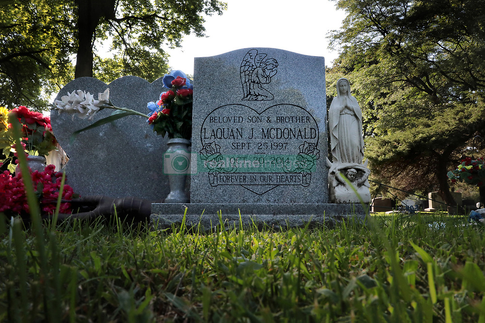 September 13, 2018 - Forest Park, IL, USA - Flowers and a statue of Mary adorn the gravesite of police shooting victim Laquan McDonald at the Forest Home Cemetery in Forest Park, Thursday, Sept. 13, 2018. Chicago police officer Jason Van Dyke is currently on trial for the shooting of Laquan McDonald. (Credit Image: © Antonio Perez/Chicago Tribune/TNS via ZUMA Wire)