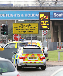 © Licensed to London News Pictures. 26/11/2015. London, UK. Police at the scene. . A group of Airport expansion activists cause traffic chaos by blocking off the inbound tunnel of Heathrow airport in London to protest against airport expansion.  Photo credit: Peter Macdiarmid/LNP