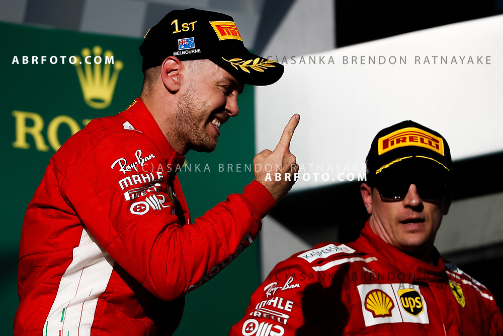 Victorious Ferrari driver Sebastian Vettel of Germany celebrates on the podium during the trophy presentation at the end of the 2018 Rolex Formula 1 Australian Grand Prix at Albert Park, Melbourne, Australia, March 24, 2018.  Asanka Brendon Ratnayake