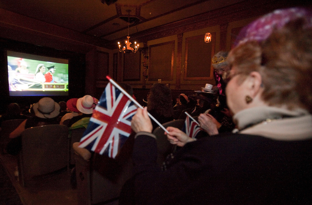 Hundreds of people gathered to watch the wedding of Prince William and Catherine Middleton on a big screen at the Palace Theatre in London, Ontario Canada April 29, 2011. <br /> AFP/GEOFF ROBINS/STR
