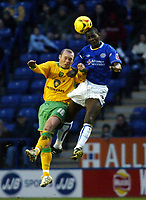 Photo: Chris Ratcliffe.<br />Leicester City v Norwich City. Coca Cola Championship. 31/12/2005.<br />Simon Charlton (L) of Norwich is beaten to the ball by Momo Sylla of Leicester.