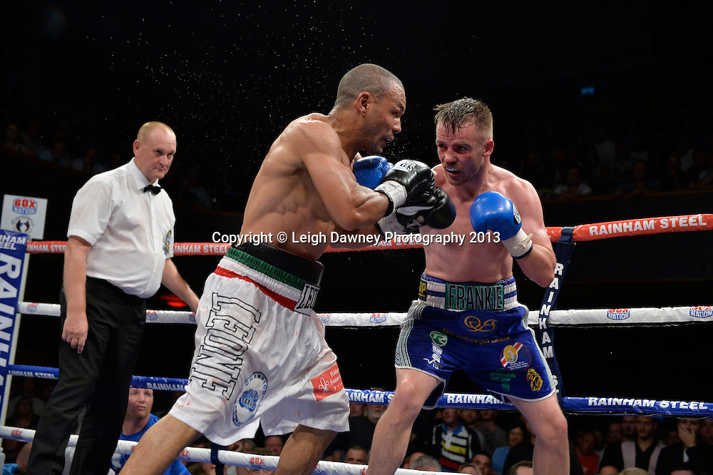 Leonard Bundu (white shorts) defeats Frankie Gavin for the European & Commonwealth Welterweight Championship at Wolverhampton Civic Hall, Wolverhampton, 1st August 2014. Promoted by Frank Warren in association with PJ Promotions. © Credit: Leigh Dawney Photography.