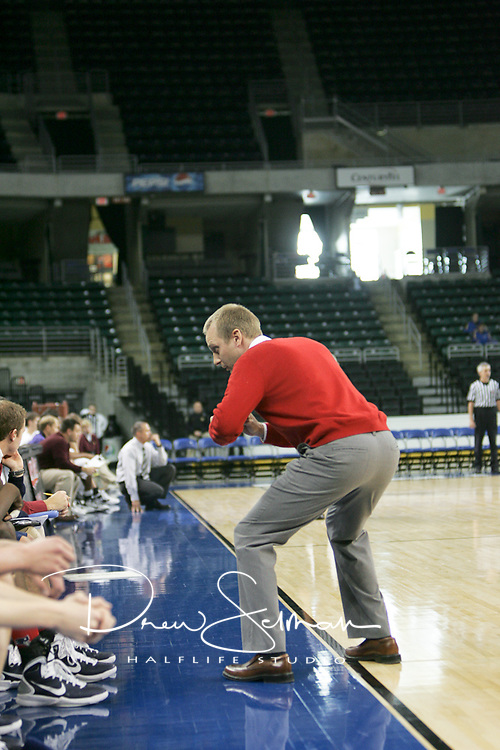 Patriot head coach Justin Moulder showing his players how he wants them to guard