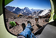 "Traveling Russian Photographer captures Breathtaking Morning Views From His Tent<br /> <br /> Imagine waking up and rolling out of bed to be greeted by a brilliant mountain sunrise, with a gurgling frigid stream below you and blue skies above you. Russian photographer Oleg Grigoryev takes us into the mountains in his ""Morning Views From The Tent"" series, in which he frames beautiful mountain photos with his outstretched legs and his tent flap.<br /> <br /> Grigoryev took these photos in the Fann Mountains of Tajikistan from campsites that were up to 4,700m above sea level, and the range has mountains that extend up to 5.5km above sea level. Given their height, it's not surprising that we see Grogoryev's legs resting in each photo!<br /> ©Oleg Grigoryev/Exclusivepix"