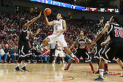 November 30, 2013: Tai Webster (0) of the Nebraska Cornhuskers makes a lay up Aaric Armstead (23) of the Northern Illinois Huskies at the Pinnacle Bank Areana, Lincoln, NE.