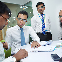 Customers and staff at a bank branch, Dhaka...Photo: Tom Pietrasik.Dhaka, Bangladesh. 2012