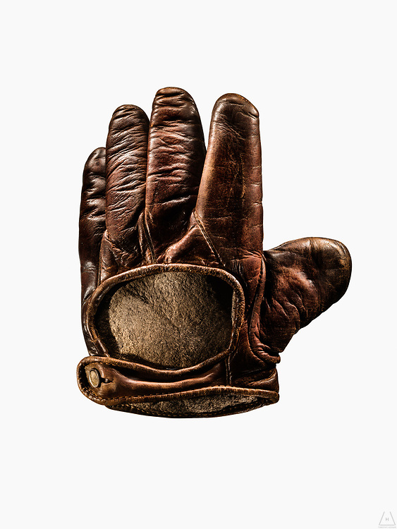 Anterior view of a vintage webless, buckle baseball glove with leather in it's finest condition