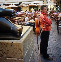 """A street musician in Plaza Santo Domingo in the """"Old City"""" in Cartagena, Colombia. (Photo/Scott Dalton)"""