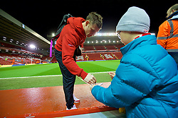 LIVERPOOL, ENGLAND - Wednesday, March 2, 2016: Liverpool's James Milner signs an autograph for a supporter before the Premier League match against Manchester City at Anfield. (Pic by David Rawcliffe/Propaganda)