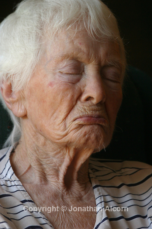 Ruthie naps in a chair at a live-in residence for Alzheimer's and dementia related  patients.