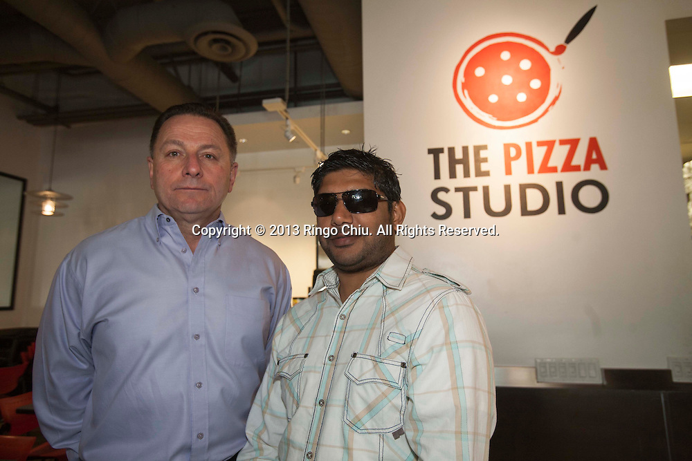 Samit Varma(R) and Ron Biskin, co-owners of Pizza Studio in Los Angeles. (Photo by Ringo Chiu/PHOTOFORMULA.com)