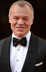 Graham Norton arrives for the BAFTA TV Awards at the Theatre Royal, London, United Kingdom. Sunday, 18th May 2014. Picture by Andrew Parsons / i-Images