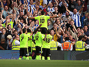 Tomer Hemed celebrating in front of brighton fans after scoring a panalty during the Sky Bet Championship match between Fulham and Brighton and Hove Albion at Craven Cottage, London, England on 15 August 2015. Photo by Matthew Redman.